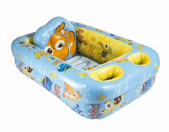 Inflatable baby bathtub for bathing a paralyzed dog.